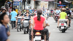 Moped Traffic in Downtown Ho Chi Minh City (Saigon) Vietnam - stock footage