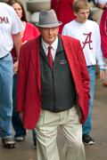 elderly alabama fan dressed like bear bryant walks to game - stock photo