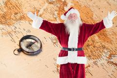 Stock Photo of Composite image of jolly santa opens his arms to camera