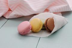 macarons in backing paper cornet - stock photo