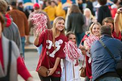 female alabama fans pose for photo outside georgia dome - stock photo