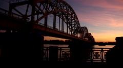 Bridge over river in dark Stock Footage