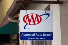 Aaa sign in front of auto repair garage Stock Photos