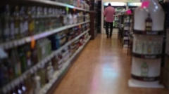 Man walking inside of a Liquor Store - stock footage