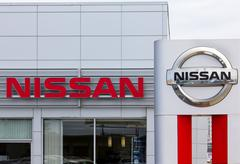 Nissan motors automobile dealership and sign. Stock Photos