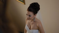 Cute brunetter bride poses to the camera - stock footage