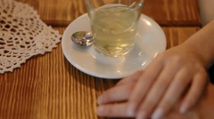 Man and woman touch each other hand in the cafe Stock Footage