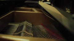 Close up shot of the inside of a Classical Piano as it is being played Stock Footage