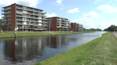 Canal side apartments on the Wilhelmina Canal, Son, North Brabant, Netherlands. Stock Footage