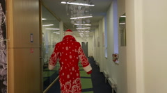 Santa Claus in the office rapidly back Stock Footage