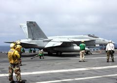 F-18  prepares for lauch from a carrier Stock Photos