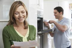 Satisfied female customer with oven repair bill Stock Photos