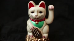 LUCKY ASIAN WAVING CAT - 60fps slomo dolly out in an arc and rerturn - stock footage