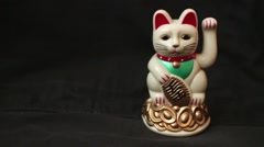 LUCKY ASIAN WAVING CAT - 60fps Slomo Dolly Left, Cat Screen Right Stock Footage