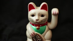 LUCKY ASIAN WAVING CAT - Shallow DOF Dolly out and Back Stock Footage
