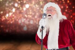 Composite image of santa sings like a superstar - stock photo