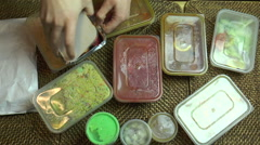 Speeded up. Hands opening an Indian takeaway meal Stock Footage