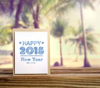 Happy new year 2015 message with palm trees Stock Photos