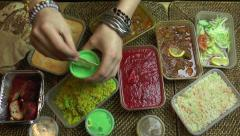 Hands dipping into an Indian takeaway meal Stock Footage