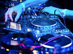 Dj playing the track in the nightclub at a party. dj headphones Stock Photos