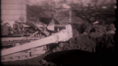 1482 caterpillar moving dirt at suburban jobsite - vintage film home movie Stock Footage