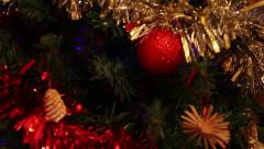 Pan on Beautiful christmas decoration on tree with lights and tinsel - stock footage