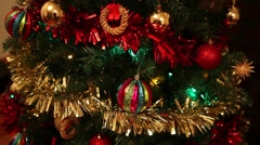 Christmas tree decorations, tinsel, balls, christmas lights flickering - stock footage
