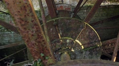 Abandoned miller wheel track out shot Stock Footage