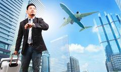 Business man and belonging luggage watching to sky and hand watch against hig Stock Photos
