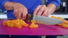 Female hands cutting Mandarin Oranges in pieces Stock Footage
