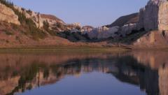 Missouri river at sunrise beautiful reflection of mountains and sky on water. Stock Footage