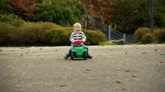 Kid fell from his toy car Stock Footage