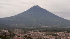 Antigua Guatemala with an active smoking volcano Stock Footage