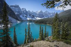 moraine lake with canoe in banff national park - stock photo