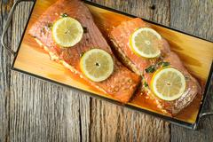 Grilled salmon cooked on a cedar plank Stock Photos