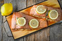 grilled salmon cooked on a cedar plank - stock photo