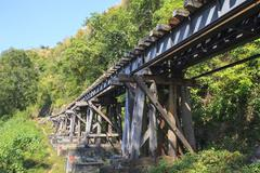 old wood structure of dead railways bridge importand landmark and destination - stock photo