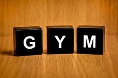 gym or gymnasium or gymnastic services word on black block - stock photo