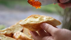 Making Sandwiches with Red Caviar on French Baguette. Stock Footage