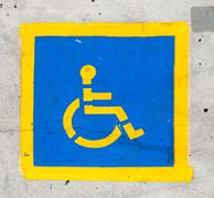 Handicapped symbol on parking space Stock Photos