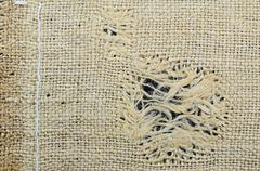 Frayed piece of old jute - stock photo