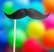 paper mustache on a stick - stock photo