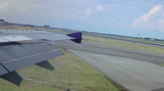 Wing of an airplane taxi runway and turn around in Airport, shot from the window Stock Footage