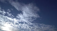 Clouds and sun move quickly in the blue sky-timelapse Stock Footage