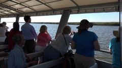 Tourists on dolphin watch wildlife boat excursion, jekyll island, ga, usa Stock Footage