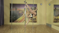 Girl performs complicated tricks on the pole - stock footage