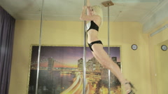 Attractive girl skillfully perform tricks on pole Stock Footage