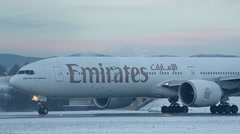 Emirates Boeing 777-300 takeoff in winter environment Stock Footage