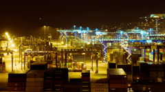 Panning overview night timelapse logistics port at night machinery cranes cargo Stock Footage