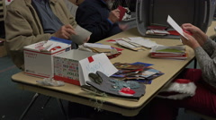 Dec Volunteers in church open Christmas Mail 4K 020 - stock footage